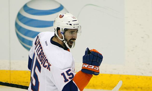 New York Islanders forward Cal Clutterbuck celebrates his goal against his former team the Minnesota Wild during the second period of their NHL hockey game, Sunday, Dec. 29, 2013, in St. Paul, Minn. (AP Photo/Andy Clayton-King)