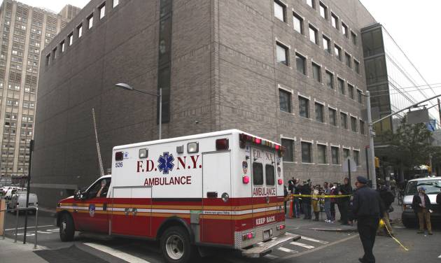 "FILE - In this Wednesday, Oct. 31, 2012 file photo, an ambulance departs Bellevue Hospital in New York where patients were being evacuated. One of two New York hospitals that had to evacuate patients at the height of Superstorm Sandy is set to begin reopening. In a statement on its website, officials at NYU Langone Medical Center say ""almost all"" practices are scheduled to restart Monday Nov. 5, 2012 though some doctors will see patients at alternate locations. At Bellevue Hospital Center an official there said the hospital could be out of commission for at least two more weeks. (AP Photo/Mark Lennihan)"
