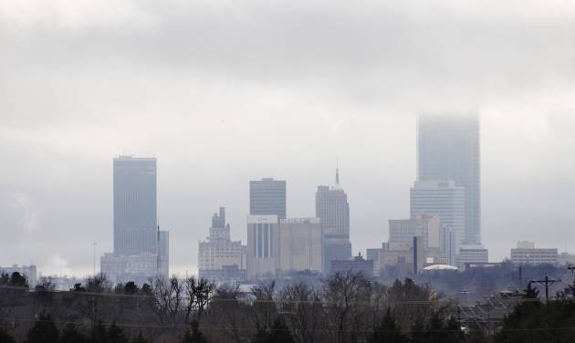 The Devon Tower disappears into the clouds of this view of the downtown Oklahoma City skyline looking south from Britton Road, Wednesday, Dec. 14, 2011. Photo by Doug Hoke, The Oklahoman