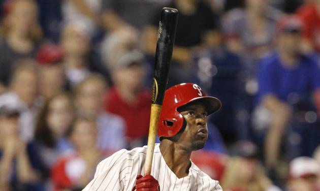 Philadelphia  Phillies Jimmy Rollins hits a double in the ninth inning of a baseball game against the Chicago Cubs to tie Mike Schmidt for career hits,  Friday, June 13, 2014 at Citizens Bank Park in Philadelphia.   ( AP Photo / The Philadelphia Inquirer, Ron Cortes)