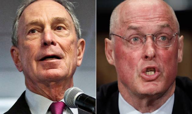 This combo made from file photos shows former New York City Mayor Michael Bloomberg, left, and former Treasury Secretary Henry Paulson. Climate change will exact enormous costs on U.S. regional economies in the form of lost property, reduced industrial output and higher health expenses, according to a report backed by Bloomberg, Paulson and Thomas F. Steyer, a former hedge fund manager. (AP Photo/Bebeto Matthews, Pablo Martinez Monsivais, File)