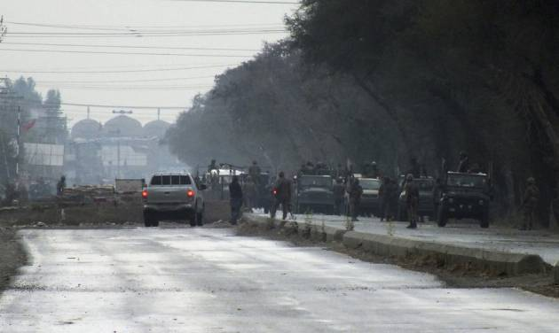 Pakistan's army troops gather at the site following a militant attack on an army post in Serai Naurang town, near Lakki Marwat, Pakistan on Saturday, Feb. 2, 2013. Militants attacked an army post in northwestern Pakistan with automatic weapons, rocket-propelled grenades and suicide vests before dawn on Saturday, killing several people including civilians, officials said. Several attackers were also reported killed in the assault. (AP Photo/Jibran Yousufsai)