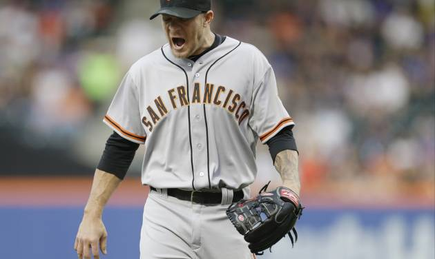 San Francisco Giants starting pitcher Jake Peavy reacts while walking off the field after pitching during the first inning of a baseball game against the New York Mets on Saturday, Aug. 2, 2014, in New York. (AP Photo/Frank Franklin II)