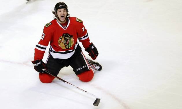 Chicago Blackhawks left wing Daniel Carcillo celebrates his winning goal during the third period of an NHL hockey game against the Colorado Avalanche, Wednesday, March 6, 2013, in Chicago. The Blackhawks won 3-2. (AP Photo/Charles Rex Arbogast)