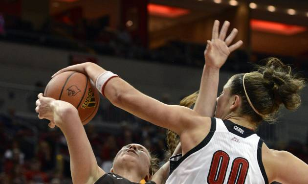 Louisville's Sara Hammond, right, blocks the shot of Valparaiso's Tabitha Gersrdot during the first half of an NCAA women's college basketball game Saturday Dec. 8, 2012, in Louisville, Ky. (AP Photo/Timothy D. Easley)