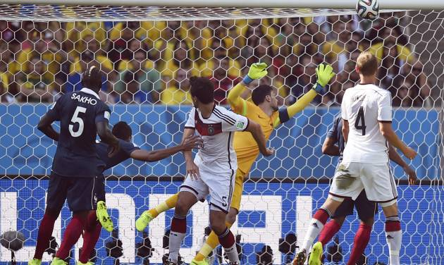 Germany's Mats Hummels, centrer, scores the opening goal during the World Cup quarterfinal soccer match between Germany and France at the Maracana Stadium in Rio de Janeiro, Brazil, Friday, July 4, 2014. (AP Photo/Martin Meissner)