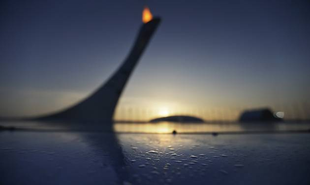 Drops of water sit along the edge of the pool at the Olympic cauldron as the sun sets at the 2014 Winter Olympics, Friday, Feb. 21, 2014, in Sochi, Russia. (AP Photo/David Goldman)