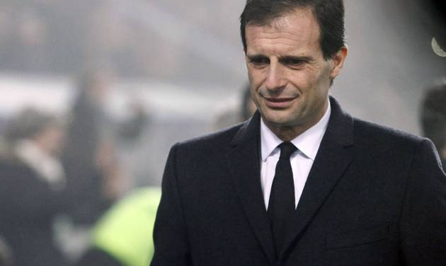 FILE - In this Jan. 12, 2014 file photo AC Milan's coach Massimiliano Allegri looks down, during a Serie A soccer match against Sassuolo, at Reggio Emilia's Mapei stadium, Italy. AC Milan announced on its website Monday, Jan. 12, 2014 that it fired Allegri and put assistant Mauro Tassotti temporarily in charge following AS Milan's embarassing 4-3 loss to Sassuolo on Sunday. (AP Photo/Davide Spada, Lapresse, file)