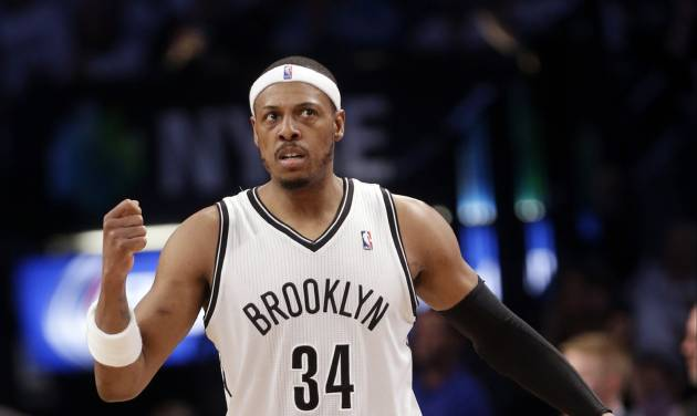 Brooklyn Nets' Paul Pierce (34) reacts after teammate Andray Blatche scores during the first half of Game 6 of the opening-round NBA basketball playoff series against the Toronto Raptors, Friday, May 2, 2014, in New York. (AP Photo/Frank Franklin II)