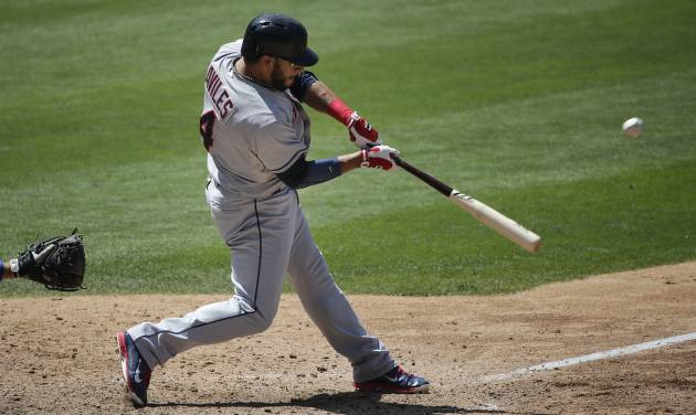 Cleveland Indians' Mike Aviles hits a two-run single during the eighth inning of a baseball game against the Los Angeles Dodgers on Wednesday, July 2, 2014, in Los Angeles. (AP Photo/Jae C. Hong)
