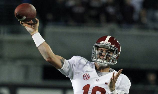 Alabama quarterback AJ McCarron (10) throws a pass during the first half of an NCAA college football game against Mississippi State, Saturday, Nov. 16, 2013, in Starkville, Miss. (AP Photo/Butch Dill)