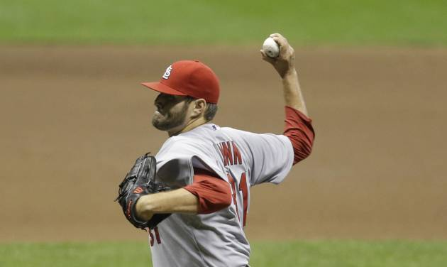 St. Louis Cardinals starting pitcher Lance Lynn throws to the Milwaukee Brewers during the first inning of  the MLB National League baseball game Monday, April 14, 2014, in Milwaukee. (AP Photo/Jeffrey Phelps)