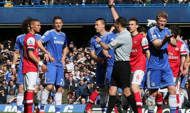 Referee Andre Marriner, in grey, sends off Arsenal's Kieran Gibbs, left, during their English Premier League soccer match between Chelsea and Arsenal at Stamford Bridge stadium in London Saturday, March 22  2014. (AP Photo/Alastair Grant)