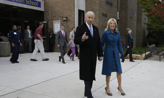 Vice President Joe Biden exits with his wife Jill Biden after voting at Alexis I. duPont High School, Tuesday, Nov. 6, 2012, in Greenville, Del. (AP Photo/Matt Rourke)