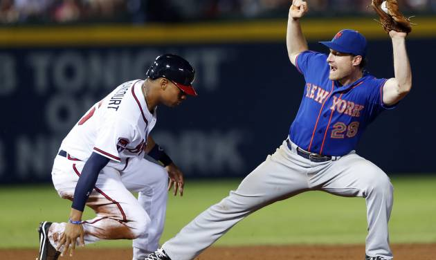Atlanta Braves' Christian Bethancourt (25) beats New York Mets second baseman Daniel Murphy (28) to the bag as he advances to second base on a B.J. Upton single in the seventh inning of a baseball game in Atlanta, Monday, June 30, 2014.  (AP Photo/John Bazemore)