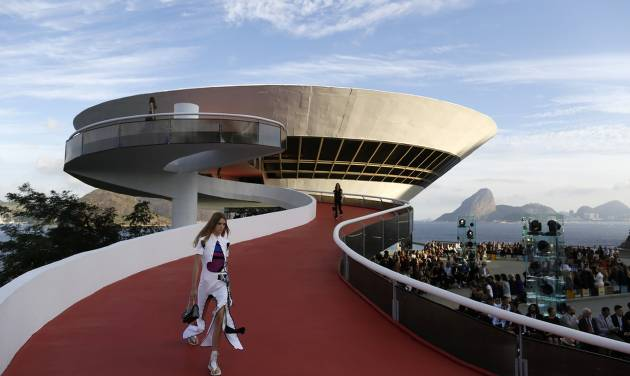 A model walks down a ramp of the Contemporary Art Museum wearing a creation from the Louis...