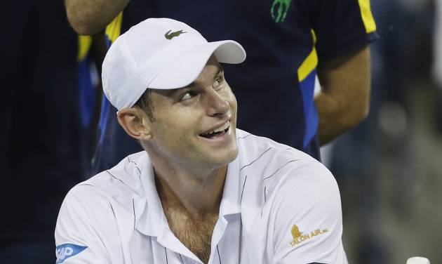 Andy Roddick reacts as rain forces a delay in his match against Argentina's Juan Martin Del Potro in the quarterfinals of the 2012 US Open tennis tournament, Tuesday, Sept. 4, 2012, in New York. (AP Photo/Charles Krupa)
