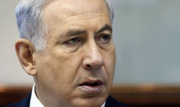 Israeli Prime Minister Benjamin Netanyahu chairs the weekly cabinet meeting in his office in Jerusalem, Sunday, July 6, 2014. Prime Minister Benjamin Netanyahu on Sunday said Israel would act calmly and responsibly in the face of rising Israeli-Palestinian hostilities, just hours after Israel's military carried out airstrikes on 10 sites in the Gaza Strip. (AP Photo/Gali Tibbon, Pool)