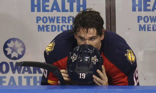 Florida Panthers' Scottie Upshall sits on the bench after the New Jersey Devils defeated the Panthers 3-2 in two overtimes in Game 7 of a first-round NHL Stanley Cup playoff hockey series in Sunrise, Fla., Wednesday, April 26, 2012. (AP Photo/J Pat Carter)
