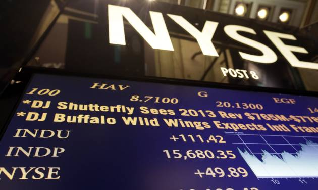 A board on the floor of the New York Stock Exchange shows the record closing number for the Dow Jones industrial average. Tuesday, Oct. 29, 2013.  (AP Photo/Richard Drew)