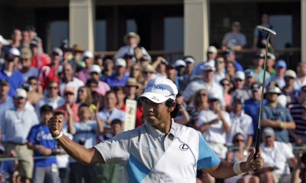 Hideki Matsuyama, of Japan, celebrates after winning the Memorial golf tournament in a playoff on Sunday, June 1, 2014, in Dublin, Ohio. (AP Photo/Jay LaPrete)