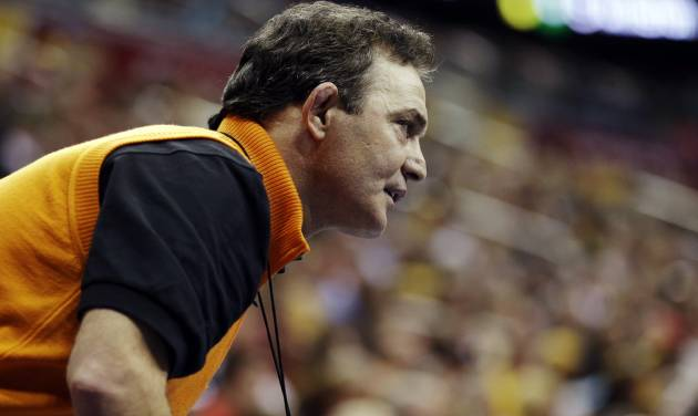 Oklahoma State coach John Smith watches a match between Alex Dieringer and Ohio's Spartak Chino in a 157-pound match at the NCAA Division I college wrestling championships, Thursday, March 21, 2013, in Des Moines, Iowa. (AP Photo/Charlie Neibergall)