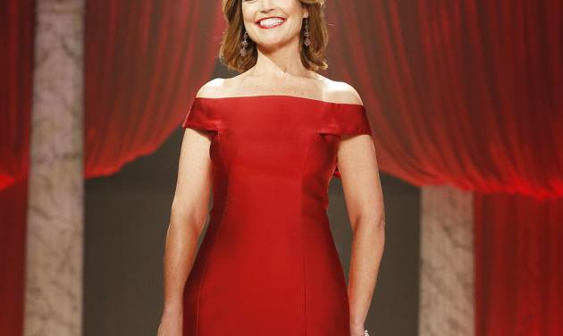 """FILE - In this Feb. 6, 2013 file photo, Savannah Guthrie walks the runway at the Red Dress Collection 2013 Fashion Show in New York. Guthrie has gotten married, and she used the occasion to announce she's expecting her first child. Guthrie and Mike Feldman, a 45-year-old communications strategist, tied the knot Saturday, March 15, 2014, near her hometown of Tucson, Ariz. It was there she told her guests she's four months pregnant. Guthrie's on-air """"Today"""" colleagues were among those on hand for the wedding ceremony. (Photo by John Minchillo/Invision/AP, File)"""
