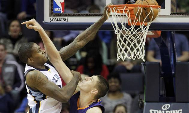 Memphis Grizzlies forward Ed Davis (32) dunks the ball over Phoenix Suns center Alex Len, right, in the first half of an NBA basketball game, Friday, Jan. 10, 2014, in Memphis, Tenn. (AP Photo/Lance Murphey)