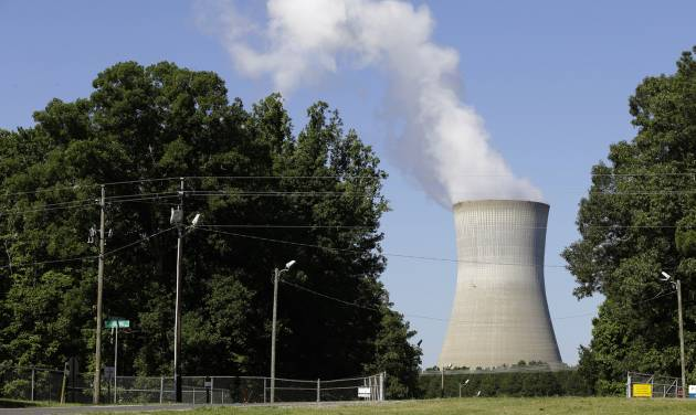 FILE - This file photo taken Friday, June 14, 2013 shows the Shearon Harris nuclear plant in Holly Springs, N.C. By court order, the Energy Department on Friday, May 16, 2014 will stop charging a fee that electric customers have been paying for 31 years to fund a federal nuclear waste site that doesn't exist. It's only a small percentage of most customers' bills, but it adds up to $750 million a year. The fund now holds $37 billion. (AP Photo/Gerry Broome, File)