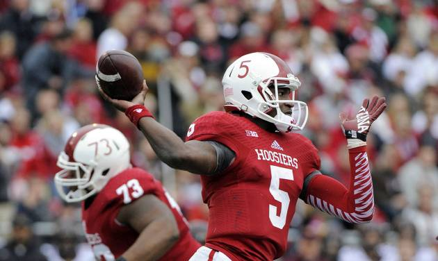 Indiana's Tre Roberson (5) throws during the first half of an NCAA college football game against Minnesota in Bloomington, Ind., Saturday, Nov. 2, 2013. (AP Photo/ Alan Petersime)