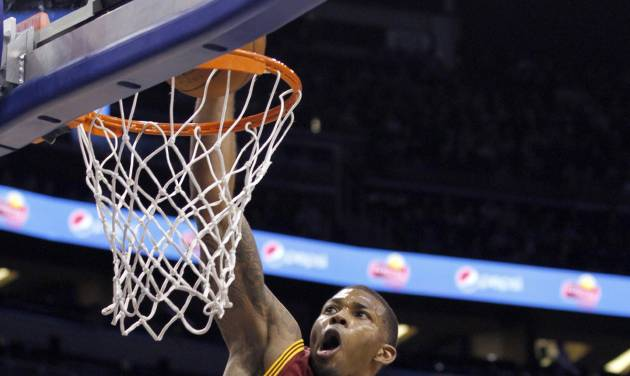 Cleveland Cavaliers forward Alonzo Gee (33) dunks during the first half of an NBA basketball game against the Orlando Magic in Orlando, Fla., on Saturday, Feb. 23, 2013. (AP Photo/Reinhold Matay)