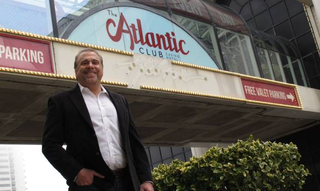 FILE - In this March 13, 2012 file photo, Michael Frawley, chief operating officer of The Atlantic Club, poses in front of the Atlantic City N.J. casino on the day it changed its name from ACH. The parent company of PokerStars, the online gambling site, wants to buy The Atlantic Club, and has asked New Jersey casino regulators for permission. (AP Photo/Wayne Parry, File)