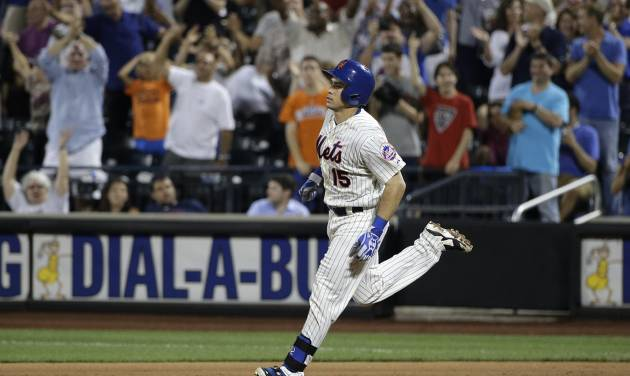 New York Mets' Travis d'Arnaud (15) rounds the bases after hitting a two-run home run against the Atlanta Braves in the seventh inning of a baseball game, Wednesday, July 9, 2014, in New York. (AP Photo/Julie Jacobson)