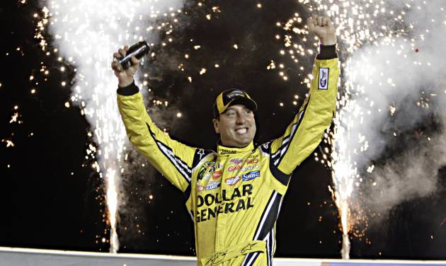 Kyle Busch celebrates in Victory Circle after winning the NASCAR Trucks auto race at Kentucky Speedway in Sparta, Ky., Thursday June 26, 2014.  (AP Photo/Garry Jones)