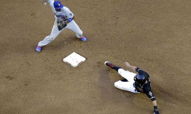 Los Angeles Dodgers' Dee Gordon, left, forces out Arizona Diamondbacks' Martin Prado while trying to turn a double play on Diamondbacks' Alfredo Marte during the fourth inning of a baseball game on Saturday, May 17, 2014, in Phoenix. Marte was safe. (AP Photo/Matt York)