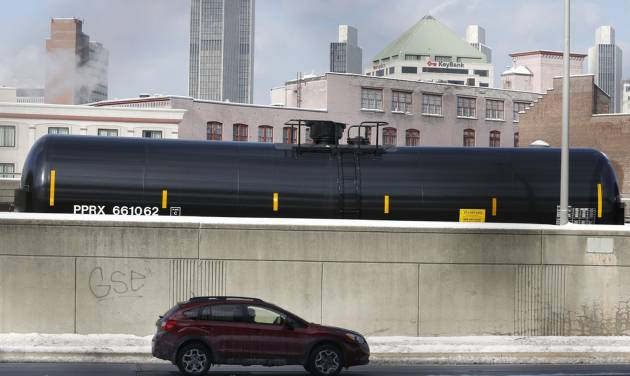 A railroad oil tanker car is parked along Interstate 787 in downtown Albany, N.Y., on Friday, Feb. 7, 2014. The Port of Albany has become a hub for the U.S. oil business, taking shipments from North Dakota's Bakken Shale daily by mile-long trains and shipping it in tankers down the Hudson River to refineries. Opponents of a proposal to build boilers to liquefy heavy crude passing through Albany by rail are drawing attention to the capital's emergence as a major hub for the transport of oil that's widely considered risky from an environmental and safety standpoint.  (AP Photo/Mike Groll)