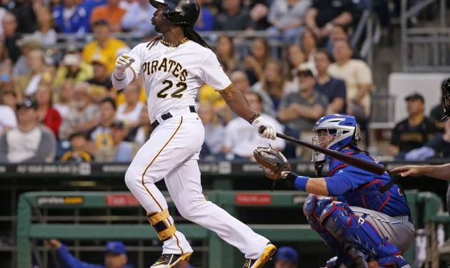Pittsburgh Pirates' Andrew McCutchen (22) hits a two-run home run off Chicago Cubs starting pitcher Edwin Jackson during the third inning of a baseball game in Pittsburgh Monday, June 9, 2014. (AP Photo/Gene J. Puskar)
