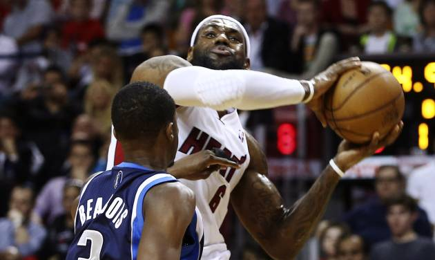 Miami Heat's LeBron James (6) works against Dallas Mavericks' Rodrigue Beaubois (3) during the first half of an NBA basketball game in Miami, Wednesday, Jan. 2, 2013. (AP Photo/J Pat Carter)
