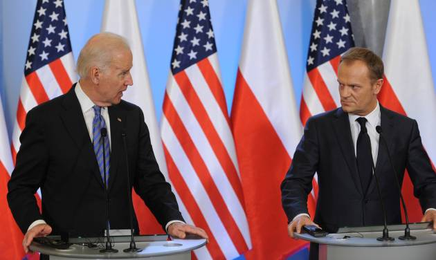 U.S. Vice President Joe Biden, left, and Polish Prime Minister Donald Tusk look at each others during a press conference after talks in Warsaw, Poland, Tuesday, March 18, 2014. Biden arrived in Warsaw for consultations with Prime Minister Donald Tusk and President Bronislaw Komorowski, a few hours after Russian President Vladimir Putin approved a draft bill for the annexation of Crimea, one of a flurry of steps to formally take over the Black Sea peninsula. (AP Photo/Alik Keplicz)