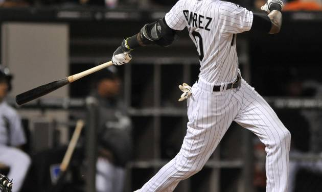 Chicago White Sox's Alexei Ramirez watches his grand slam during the fourth inning of a baseball game against the Arizona Diamondbacks in Chicago, Friday, May 9, 2014. (AP Photo/Paul Beaty)