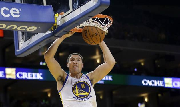 Golden State Warriors' Klay Thompson dunks past Sacramento Kings' Marcus Thornton (23) during the second half of an NBA preseason basketball game Monday, Oct. 7, 2013, in Oakland, Calif. (AP Photo/Marcio Jose Sanchez)