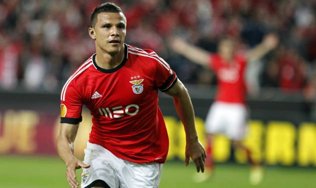 Benfica's Lima, from Brazil, celebrates after scoring his side's second goal against Juventus during the Europa League semifinal first leg soccer match between Benfica and Juventus at Benfica's Luz stadium in Lisbon, Thursday, April 24, 2014. Lima  scored once in Benfica's 2-1 victory. (AP Photo/Francisco Seco)