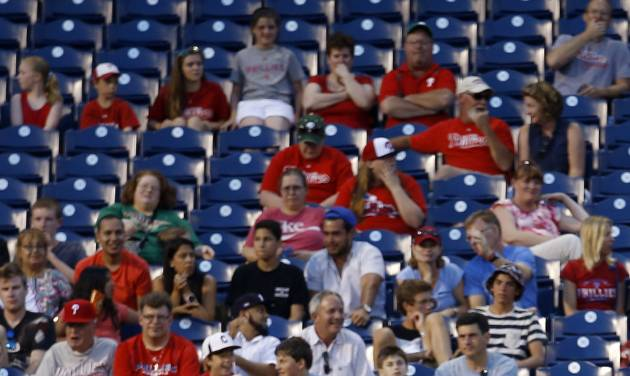 Philadelphia Phillies left fielder Domonic Brown walks back to his position after misplaying run-scoring double by Miami Marlins' Marcell Ozuna during the fourth inning of a baseball game, Wednesday, June 25, 2014, in Philadelphia. Miami won 3-2. (AP Photo/Matt Slocum)