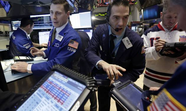 FILE - In this Friday, Feb. 21, 2014, file photo, trader Gregory Rowe, center, works at the post of specialist Joseph Mastrolia, left, on the floor of the New York Stock Exchange. Global stocks were mostly lower Tuesday, Feb. 25, 2014, amid jitters about China's housing market and weakness in the country's currency. (AP Photo/Richard Drew, File)