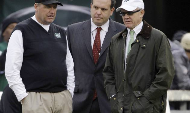 """FILE - In this Dec. 2, 2012 file photo, New York Jets head coach Rex Ryan, left, stands with general manager Mike Tannenbaum, center, and owner Woody Johnson before an NFL football game against the Arizona Cardinals in East Rutherford, N.J. The New York Jets have fired Tannenbaum and say Ryan will be back next season. Johnson said in a statement Monday, Dec. 31, 2012, that """"like all Jets fans, I am disappointed with this year's results."""" (AP Photo/Kathy Willens, File)"""