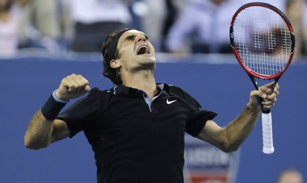 Roger Federer, of Switzerland, celebrates his win over Gael Monfils, of France, during the quarterfinal round of the 2014 U.S. Open tennis tournament, Thursday, Sept. 4, 2014, in New York. Federer defeated Monfils 4-6, 3-6, 6-4, 7-5, 6-2. (AP Photo/Charles Krupa)