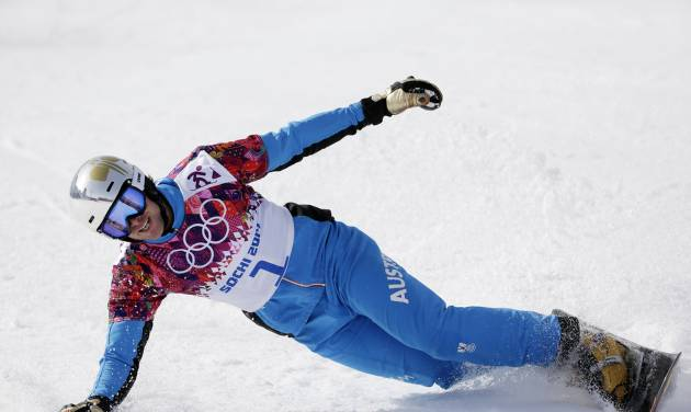 Austria's Benjamin Karl celebrates after taking the bronze medal in the men's snowboard parallel slalom final at the Rosa Khutor Extreme Park, at the 2014 Winter Olympics, Saturday, Feb. 22, 2014, in Krasnaya Polyana, Russia. (AP Photo/Andy Wong)