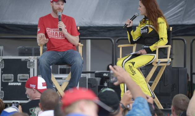 Dale Earnhardt Jr., left, talks with Miss Sprint Cup, Madision Martin, during an interview after he was named NASCAR's most popular driver prior to the Sprint cup Series auto race at Daytona International Speedway in Daytona Beach, Fla., Saturday, July 5, 2014. (AP Photo/Phelan M. Ebenhack)