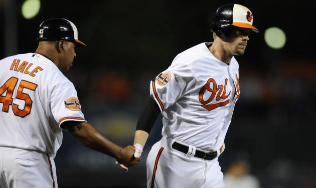 Baltimore Orioles' Matt Wieters, right, is greeted by third base coach DeMarlo Hale (45) after he hit a three-run home run against the New York Yankees during the first inning of a baseball game, Thursday, Sept. 6, 2012, in Baltimore. (AP Photo/Nick Wass)