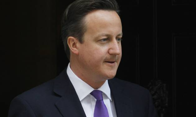 British Prime Minister David Cameron leaves 10 Downing Street in London, Thursday, June 14, 2012. Cameron is due to give evidence at the Leveson Inquiry, a judge-led inquiry into media ethics, at the High Court in London on Thursday. (AP Photo/Sang Tan)